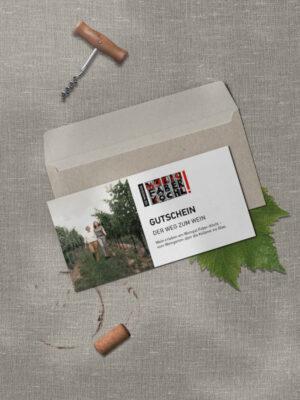 """Gutschein mit Aufschrift """"Der Weg zum Wein"""" und Kuvert"""